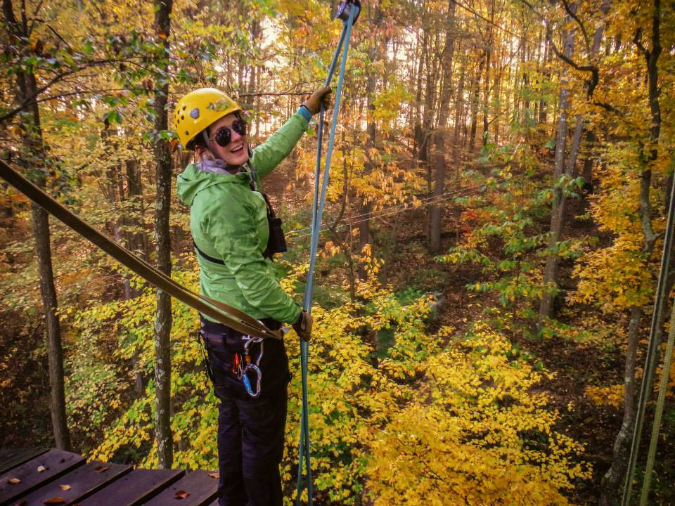 Zipline Guide rappelling at mid point of canopy tour